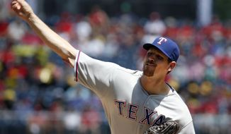 Texas Rangers starting pitcher Nick Tepesch throws during the first inning of a baseball game against the Washington Nationals at Nationals Park Saturday, May 31, 2014, in Washington. (AP Photo/Alex Brandon)