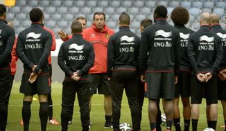 Belgium's national soccer team coach Marc Wilmots, center, talks to his players during a training session at Friends Arena in Stockholm, Sweden, Saturday May 31, 2013. The Belgian team, heading for the World Cup, will play a friendly with Sweden Sunday, June 1. (AP photo/Janerik Henriksson, TT news Agency)    SWEDEN OUT