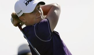 Stacy Lewis hits a tee shot on the fifth hole during the second round of the ShopRite LPGA Classic golf tournament in Galloway Township, N.J., Saturday, May 31, 2014. (AP Photo/Mel Evans)