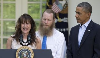Accompanied by President Barack Obama, Jani Bergdahl, and Bob Bergdahl speak during a news conference in the Rose Garden of the White House in Washington on Saturday, May 31, 2014 about the release of their son, U.S. Army Sgt. Bowe Bergdahl. Bergdahl, 28, had been held prisoner by the Taliban since June 30, 2009. He was handed over to U.S. special forces by the Taliban in exchange for the release of five Afghan detainees held by the United States. (AP Photo/Carolyn Kaster)