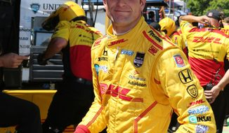 Indianapolis 500 winner  Ryan Hunter-Reay is seen in the pit area after a practice session for the IndyCar Detroit Grand Prix auto race on Belle Isle in Detroit, Friday, May 30, 2014. (AP Photo/Bob Brodbeck)