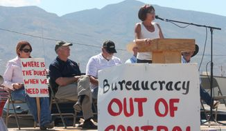 District 51 State Representative Y??vette Herrell speaks to hundreds of cattle ranchers, politicians and concerned citizens during a Freedom Rally in support of ??private property rights, water and grazing rights at the Otero County Fairgrounds in Alamogordo, N.M., on Saturday, May 31, 2014. (AP Photo/Alamogordo Daily News, Alex Quintana)