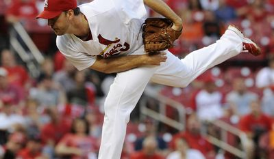St. Louis Cardinals starting pitcher Adam Wainwright throws against the San Francisco Giants in the first inning in a baseball game on Friday, May 30, 2014, in St. Louis. (AP Photo/Bill Boyce)
