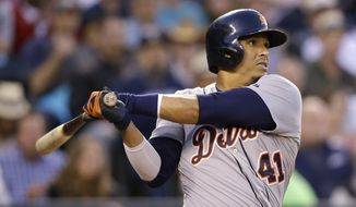 Detroit Tigers' Victor Martinez watches the path of his three-run home run against the Seattle Mariners in the fifth inning of a baseball game Friday, May 30, 2014, in Seattle. (AP Photo/Elaine Thompson)
