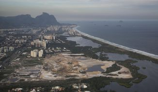 This May 13, 2014 aerial photo, shows the Rio 2016 Olympic golf course under construction in Rio de Janeiro, Brazil. Grass has been going down for several weeks at the course, which created an upbeat mood as golf prepares to return to the Olympics after a 112-year absence. That changed Saturday, May 31, 2014 when Rio organizers confirmed that a state prosecutor could halt work on the course unless the developer shows it is following environmental regulations and other requirements under Brazilian law. (AP Photo/Felipe Dana)