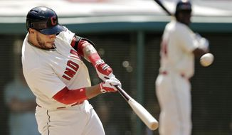 Cleveland Indians' Mike Aviles hits a three-run home run off Colorado Rockies starting pitcher Franklin Morales in the second inning of a baseball game Saturday, May 31, 2014, in Cleveland. (AP Photo/Mark Duncan)