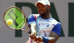 Donald Young of the U.S. returns the ball during the third round match of the French Open tennis tournament against Spain's Guillermo Garcia-Lopez at the Roland Garros stadium, in Paris, France, Saturday, May 31, 2014. (AP Photo/Darko Vojinovic)