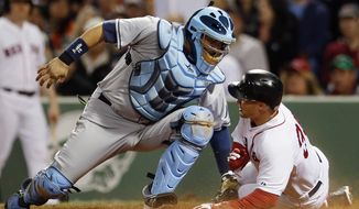 Boston Red Sox's Grady Sizemore, right, scores as Tampa Bay Rays' Jose Molina, left, applies a late tag on a bunt by Red Sox's  Jonathan Herrera in the fourth inning of a baseball game in Boston, Saturday, May 31, 2014. (AP Photo/Michael Dwyer)
