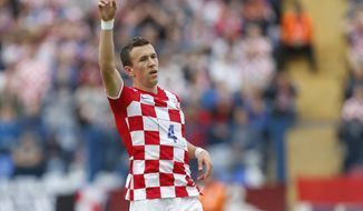 Croatia'sIvan Perisic celebrates his second goal during the internationa friendly soccer match between Croatia and Mali, in Osijek, Croatia, Saturday, May 31, 2014. (AP Photo/Darko Bandic)