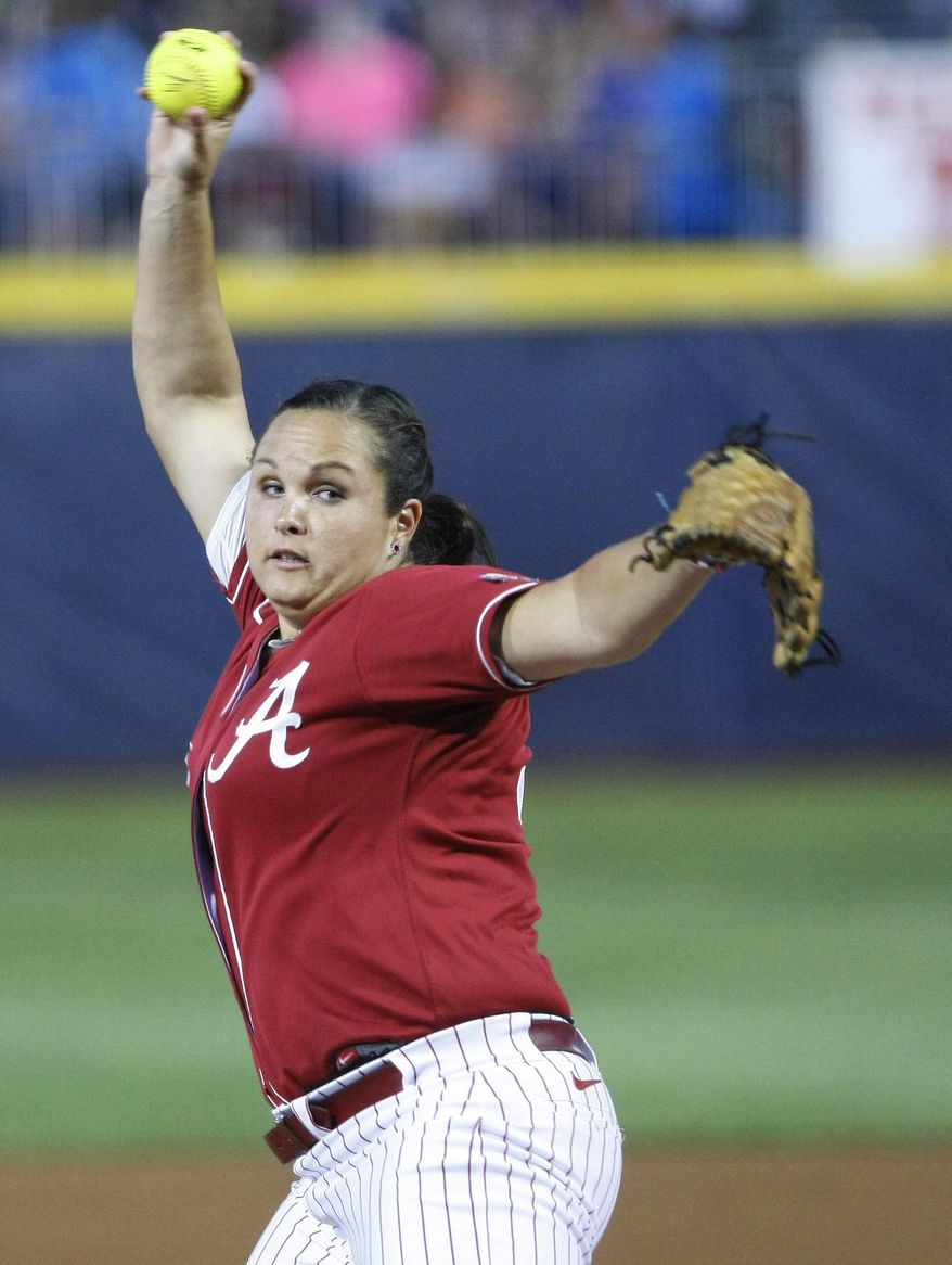 Alabama starter Jaclyn Traina pitches against Kentucky during the first inning of an NCAA Women's College World Series softball tournament game in Oklahoma City, Friday, May 30, 2014. (AP Photo/Alonzo Adams)