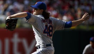 New York Mets' Jacob deGrom pitches during the fifth inning of a baseball game against the Philadelphia Phillies, Saturday, May 31, 2014, in Philadelphia. (AP Photo/Chris Szagola)