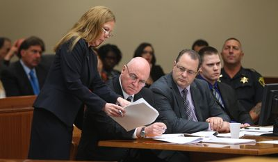 District Attorney Sandra Doorley, left, confers with defense attorney's Mark Curley, second from left, and John Leonard along with their client Clayton Whittemore, during closing arguments Thursday, May 29, 2014, in Rochester, N.Y. The 22-year-old Whittemore was charged in the September 2012 beating death of 18-year-old girlfriend Alexandra Kogut inside her dorm room at the State University of New York College at Brockport, 15 miles west of Rochester. (AP Photo/Democrat & Chronicle, Jamie Germano)  MAGS OUT; NO SALES