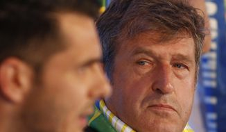 Bosnia's national soccer coach, Safet Susic, right, looks at Emir Spahic, left, during a news conference at Sarajevo Airport, Bosnia, Tuesday, May 27, 2014 from where they are flying to the United States to play pre-World Cup friendly matches. Bosnia will face Argentina, Iran and Nigeria in group F of the World Cup finals of Brazil 2014. (AP Photo/Amel Emric)