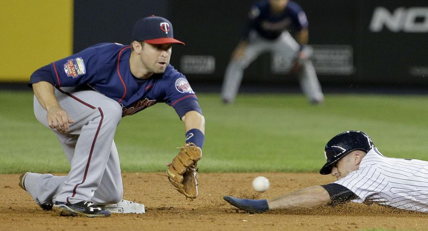 New York Yankees' Brett Gardner, right, slides safely into second base  for a steal ahead of the throw to Minnesota Twins second baseman Brian Dozier (2) during the fifth inning on Friday, May 30, 2014, in New York. (AP Photo/Julie Jacobson)