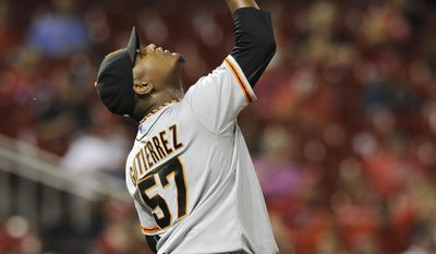 San Francisco Giants' relief pitcher Juan Gutierrez (57) reacts after his team's victory over the St. Louis Cardinals in a baseball game on Friday, May 30, 2014, at Busch Stadium in St. Louis. (AP Photo/Bill Boyce)