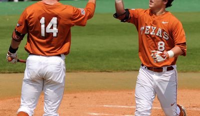Texas' Brooks Marlow, right, celebrates his solo home run with Ben Johnson during the first inning against Texas A&M in an NCAA college baseball tournament regional game Friday, May 30, 2014, at Reckling Park in Houston. (AP Photo/Houston Chronicle, Eric Christian Smith) MANDATORY CREDIT