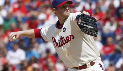 Philadelphia Phillies starting pitcher Kyle Kendrick pitches during the first inning of a baseball game against the New York Mets, Saturday, May 31, 2014, in Philadelphia. (AP Photo/Chris Szagola)