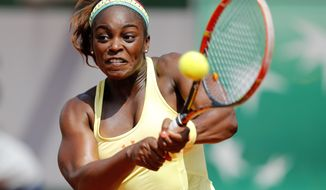 Sloane Stephens of the U.S. returns the ball during the third round match of the French Open tennis tournament against Russia's Ekaterina Makarova at the Roland Garros stadium, in Paris, France, Saturday, May 31, 2014. Stephens won on two sets 6-3, 6-4. (AP Photo/David Vincent)