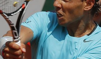 Spain's Rafael Nadal returns during the third round match of the French Open tennis tournament against Argentina's Leonardo Mayer at the Roland Garros stadium, in Paris, France, Saturday, May 31, 2014. (AP Photo/Michel Euler)