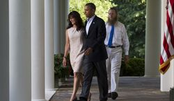 Jani Bergdahl, left, and Bob Bergdahl, walk with President Barack Obama for a news conference in the Rose Garden of the White House in Washington on Saturday, May 31, 2014 about the release of their son, U.S. Army Sgt. Bowe Bergdahl. Bergdahl, 28, had been held prisoner by the Taliban since June 30, 2009. He was handed over to U.S. special forces by the Taliban in exchange for the release of five Afghan detainees held by the United States. (AP Photo/Jacquelyn Martin)
