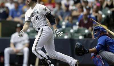 Milwaukee Brewers' Ryan Braun (8) watches his two-run home run against the Chicago Cubs in the first inning of a baseball game on Sunday, June 1, 2014, in Milwaukee. (AP Photo/Jeffrey Phelps)