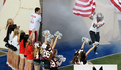 National Edition News cover for June 2, 2014 - Indians disagree on embattled Redskins nickname: The Union Redskins carry American flags onto the field before their game against Jenks in the Backyard Bowl at H.A. Chapman Stadium, Sept. 9, 2011. JEFF LAUTENBERGER/Tulsa World