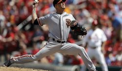 San Francisco Giants starting pitcher Tim Hudson throws during the fifth inning of a baseball game against the St. Louis Cardinals, Sunday, June 1, 2014, in St. Louis. (AP Photo/Jeff Roberson)