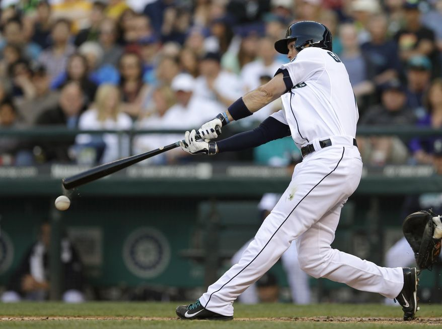 Seattle Mariners' Cole Gillespie hits an RBI single in the second inning of a baseball game against the Detroit Tigers, Saturday, May 31, 2014, in Seattle. (AP Photo/Ted S. Warren)