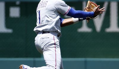 Texas Rangers shortstop Elvis Andrus (1) catches a ball hit by Washington Nationals' Jayson Werth during the first inning of a baseball game at Nationals Park, Sunday, June 1, 2014, in Washington. (AP Photo/Alex Brandon)