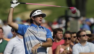 Bubba Watson watches his tee shot on the 15th hole during the final round of the Memorial golf tournament on Sunday, June 1, 2014, in Dublin, Ohio. (AP Photo/Jay LaPrete)