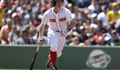 Boston Red Sox's Brock Holt advances after hitting a ground rule double off a pitch by Tampa Bay Rays' Erik Bedard in the third inning of a baseball game, Sunday, June 1, 2014, in Boston. (AP Photo/Steven Senne)