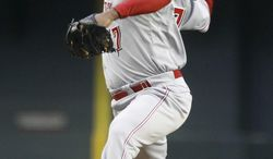 Cincinnati Reds' Johnny Cueto delivers a pitch against the Arizona Diamondbacks during the first inning of a baseball game on Saturday, May 31, 2014, in Phoenix. (AP Photo/Ralph Freso)