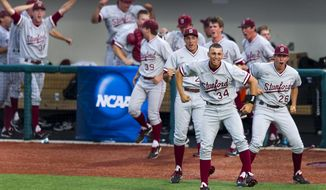 Players from the Standford bench erupt in cheers as Stanford University's Wayne Taylor (7) rounds the bases after hitting a three-run homer during an NCAA college baseball regional tournament game in Bloomington, Ind., Sunday, June 1, 2014. Stanford defeated Indiana 10-7. (AP Photo/Doug McSchooler)