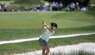 Jennifer Johnson hits from a sand trap on the first hole during the final round of the ShopRite LPGA Classic golf tournament in Galloway Township, N.J., Sunday, June 1, 2014. (AP Photo/Mel Evans)