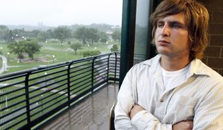 Logan Petik of Sioux Falls, S.D. looks over Falls Park in Sioux Falls on June 1, 2014, in Sioux Falls, SD. Petik entered the drug court in Sioux Falls in 2011 and has been sober for the last three years. He credits the program for helping him turn his life around. The Sioux Falls court has been around since 2010 and served around 40 people so far. (AP Photo/Dave Eggen)