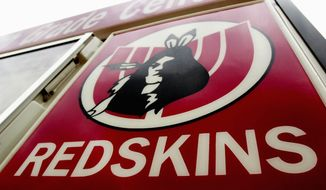 School spirit: A Redskins emblem at Union 6th/7th Grade Center. Indian groups want students to learn more about them beyond such logos. (Tulsa World)