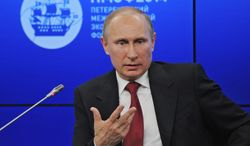 """One analyst suggests that Russian President Vladimir Putin's shifting mood is connected to the realization that war with neighboring Ukraine would have """"extremely unpredictable consequences"""" at home and in the international arena. (Associated Press)"""
