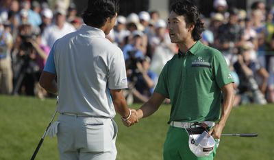 Kevin Na, right,  congratulates Hideki Matsuyama, of Japan, after Matsuyama defeated Na in a playoff during the final round of the Memorial golf tournament Sunday, June 1, 2014, in Dublin, Ohio. (AP Photo/Jay LaPrete)