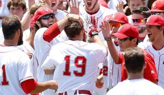 Louisiana-Lafayette's Jace Conrad (19) celebrates with his team after hitting a grand slam in the second inning during an NCAA college baseball tournament regional game against Jackson State, Sunday, June 1, 2014, in Lafayette, La. (AP Photo/Jonathan Bachman)