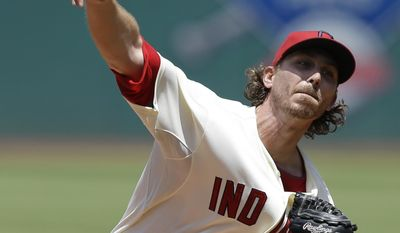 Cleveland Indians starting pitcher Josh Tomlin delivers in the first inning of a baseball game against the Colorado Rockies, Sunday, June 1, 2014, in Cleveland. (AP Photo/Tony Dejak)