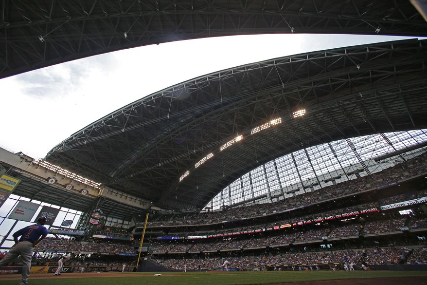 The roof opens during the sixth inning of a baseball game between the Chicago Cubs and the Milwaukee Brewers, Sunday, June 1, 2014, in Milwaukee. (AP Photo/Jeffrey Phelps)