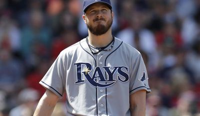 Tampa Bay Rays pitcher Erik Bedard grimaces as he looks up from the mound after giving up runs to the Boston Red Sox in the fourth inning of a baseball game, Sunday, June 1, 2014, in Boston. (AP Photo/Steven Senne)
