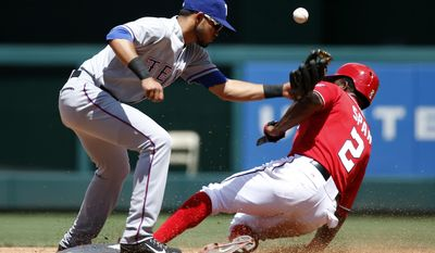 Washington Nationals' Denard Span (2) safely steals second as Texas Rangers second baseman Luis Sardinas (3) can't hang onto the ball during the third inning of a baseball game at Nationals Park, Sunday, June 1, 2014, in Washington. (AP Photo/Alex Brandon)