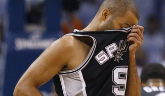 San Antonio Spurs guard Tony Parker wipes his brow between plays against the Oklahoma City Thunder in the first half of Game 6 of the Western Conference finals NBA basketball playoff series, in Oklahoma City, Saturday, May 31, 2014. (AP Photo/Sue Ogrocki)