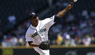 Seattle Mariners starting pitcher Roenis Elias throws against the Detroit Tigers in the second inning of a baseball game, Sunday, June 1, 2014, in Seattle. (AP Photo/Ted S. Warren)