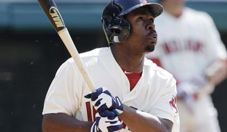 Cleveland Indians' Michael Bourn watches his ball after hitting a two-run home run off Colorado Rockies relief pitcher Adam Ottavino during the ninth inning of a baseball game on Sunday, June 1, 2014, in Cleveland. Indians' Mike Aviles scored. The Indians defeated the Rockies 6-4. (AP Photo/Tony Dejak)