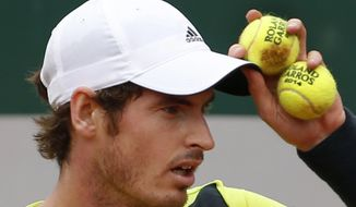 Britain's Andy Murray prepares to serve the ball during the third round match of the French Open tennis tournament against Germany's Philipp Kohlschreiber at the Roland Garros stadium, in Paris, France, Sunday, June 1, 2014. Murray won in five sets 3-6, 6-3, 6-3, 4-6, 12-10. (AP Photo/Darko Vojinovic)