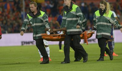 Ghana's jerry Akaminko is carried from the pitch after being injured during the international friendly soccer match between The Netherlands and Ghana at De Kuip stadium in Rotterdam, Netherlands, Saturday, May 31, 2014. (AP photo/Ermindo Armino)