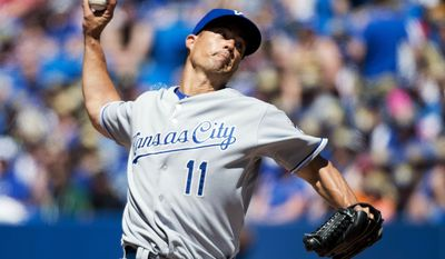Kansas City Royals starting pitcher Jeremy Guthrie works against the Toronto Blue Jays during the seventh inning of baseball game in Toronto on Sunday, June 1, 2014. (AP Photo/The Canadian Press, Nathan Denette)