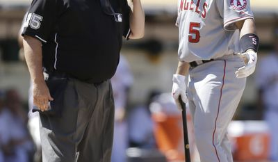 Los Angeles Angels' Albert Pujols, right, argues a strike call with home plate umpire Fieldin Culbreth in the seventh inning of a baseball game against the Oakland Athletics, Sunday, June 1, 2014, in Oakland, Calif. (AP Photo/Ben Margot)